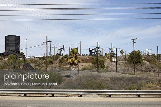 Oil fields by roadside - p378m921260 by Marcus Bastel
