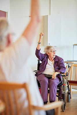 Senior woman on wheelchair - p312m1054687f by Jan Tove