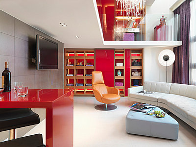 Modern apartment home with red wall - p5551914f by Marc Gerritsen