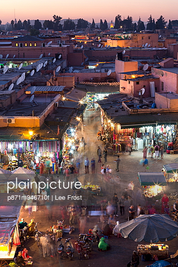 Crowds of locals and tourists walking among the shops and stalls in the Djemaa el Fna at sunset, Marrakech, Morocco, North Africa, Africa