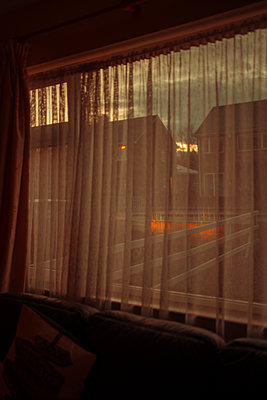 Residential houses in Dundalk seen through curtain, Ireland - p1681m2283659 by Juan Alfonso Solis