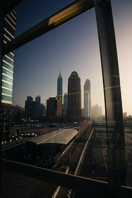 UAE, Dubai, view through window at skyline - p300m1114909f by Mauro Grigollo