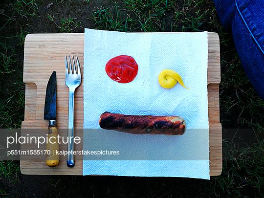Fried sausage - p551m1585170 by Kai Peters