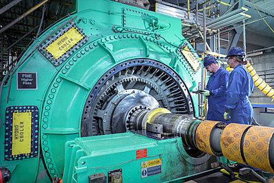 Engineers inspecting generator in nuclear power station during outage - p429m2058273 by Monty Rakusen