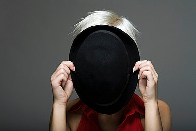 Blonde woman behind hat - p7700035 by mbphoto