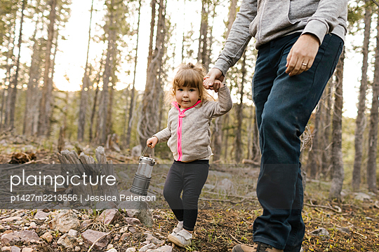 Father with daughter (2-3) walking in forest, Wasatch Cache National Forest - p1427m2213556 by Jessica Peterson