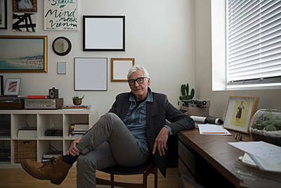 Portrait smiling, confident senior businessman entrepreneur in studio office - p1192m1529922 by Hero Images