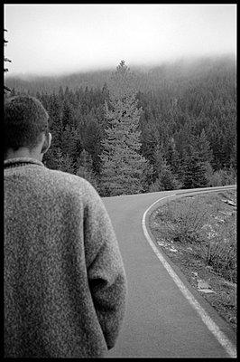 Man on walk in mountains - p3720276 by James Godman