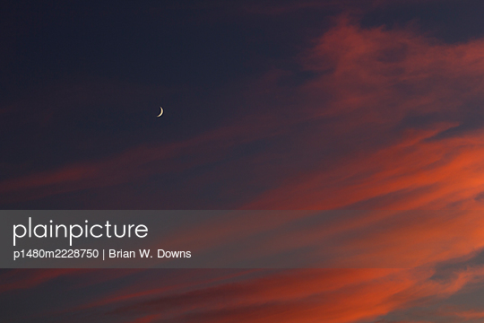 Play of colours and crescent in the night sky - p1480m2228750 by Brian W. Downs