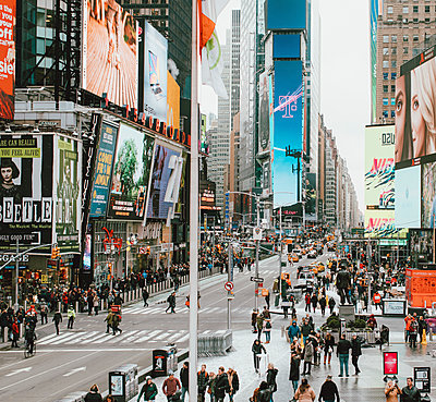 Advertisements along bustling Times Square, New York City, New York, USA - p301m2213636 by Toby Mitchell
