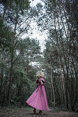 Woman dancing in a forest - p427m944781 by Ralf Mohr