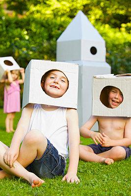 Boys Wearing Homemade Cardboard Helmets - p669m713952 by Jutta Klee photography