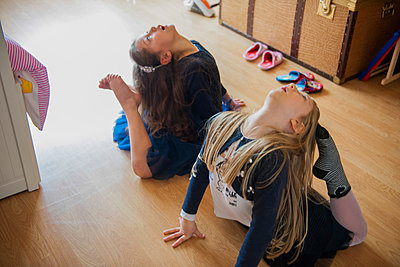 Girls stretching with toes touching heads - p429m1469579 by G. Mazzarini