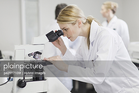 Scientist working in pathology lab - p42917109f by Hybrid Images
