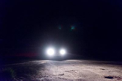 Automobile headlights at night - p1041m1042394 by Franckaparis