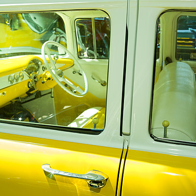 classic yellow car - p1201m2013652 by Paul Abbitt