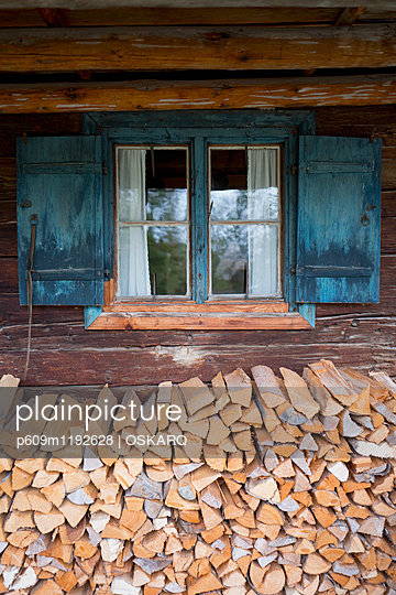 Old cabin cottage window shutters wood pile fire - p609m1192628 by OSKARQ