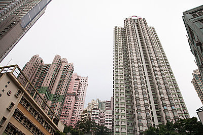 Hong kong, low angle view of apartment buildings - p9244882f by Image Source