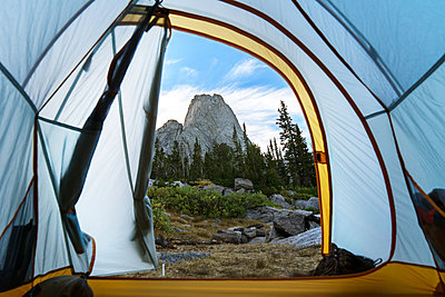 Rock formation and trees seen through tent at dusk - p1166m1186146 by Cavan Images