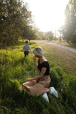 Woman and son in park - p1363m2134657 by Valery Skurydin