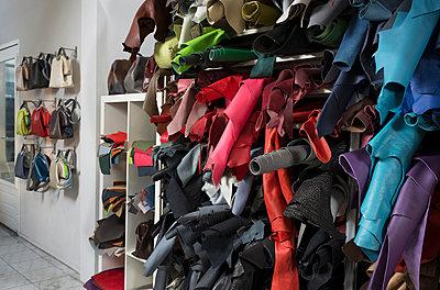Shelves of leather skins in bag shop - p429m1140135 by Mischa Keijser