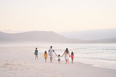 Family holding hands walking on ocean beach, Cape Town, South Africa - p1023m2200843 by Trevor Adeline