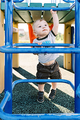 One year old exploring the playground. - p1166m2159556 by Cavan Images