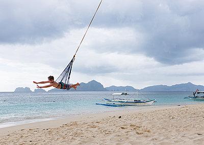 Boy in Rope Swing - p1503m2015890 by Deb Schwedhelm