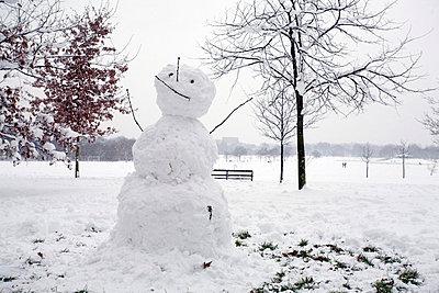 Snowman in park - p3882274 by Astrid Schulz