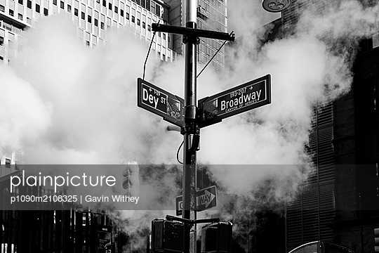 Street signs and steam in New York City - p1090m2108325 by Gavin Withey