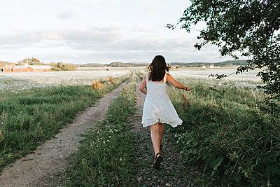 Running on a dirt road - p1507m2168020 by Emma Grann