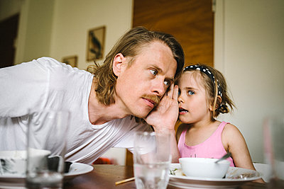 Father and daughter at table - p312m2217232 by Stina Gränfors