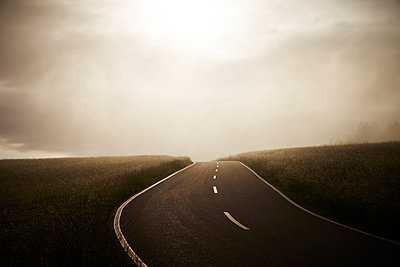 Deserted country road at dawn - p1312m2168093 by Axel Killian