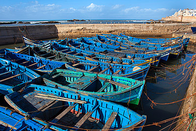 Blue boats docked in harbor - p429m768788f by Henglein and Steets
