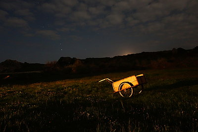 Hand cart on field at night - p1189m1218663 by Adnan Arnaout