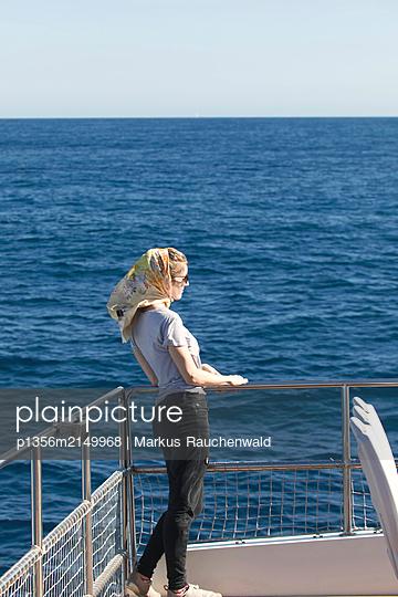 Woman on ferry - p1356m2149968 by Markus Rauchenwald