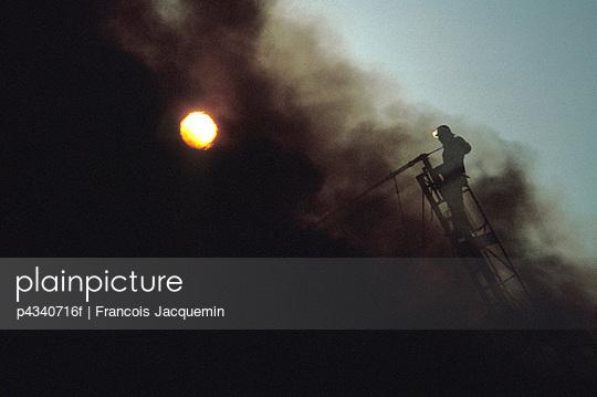 Fireman on Ladder in Smoke