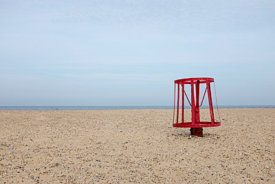 Red metal buoy on the beach - p1228m1466238 by Benjamin Harte