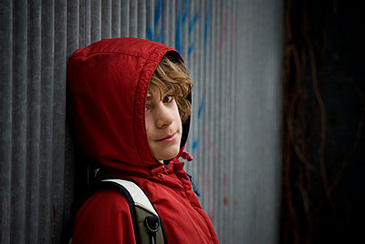 Teenage boy; Boy wearing a hooded jacket - p4429505f by Design Pics