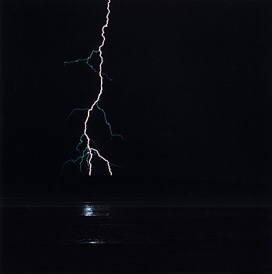 Lightning over water at night, New Mexico, USA - p3011473f by fStop