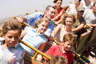 People riding a rollercoaster - p9249971f by Image Source