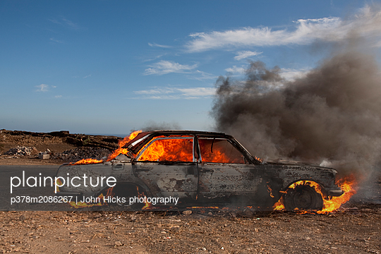 burning car - p378m2086267 by John Hicks photography