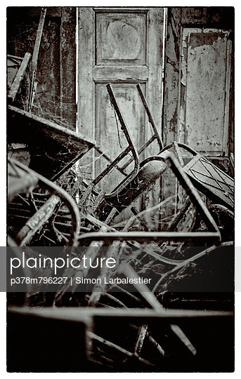 Stack of metal chairs - p378m796227 by Simon Larbalestier