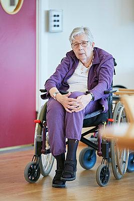 Senior woman on wheelchair - p312m1054691f by Jan Tove