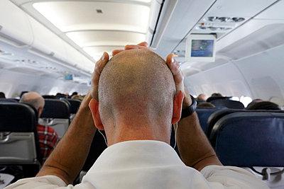 Passenger in airplane feeling unwell - p265m753511 by Oote Boe