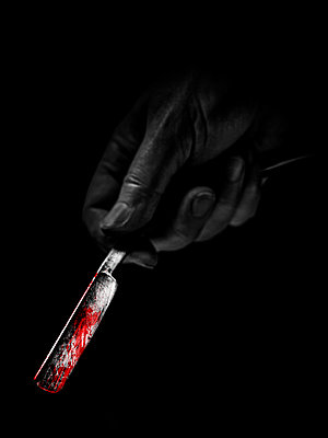 Hand holding bloody razor - p1280m2151518 by Dave Wall