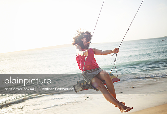 Swinging at the sea - p1198m2278744 by Guenther Schwering