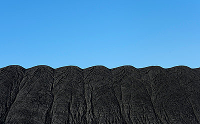 Mountains made of coal, to be burned in the nearby power station - p429m974521f by Mischa Keijser