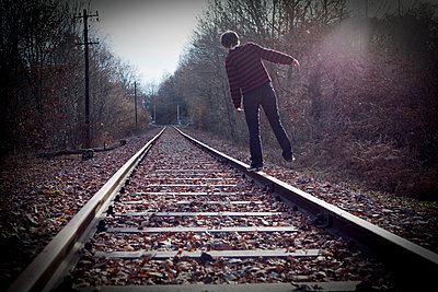 Walking on the rails in the forest - p1513m2043982 by ESTELLE FENECH