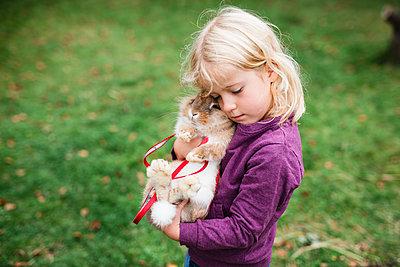 Girl hugging rabbit - p312m2079743 by Anna Johnsson